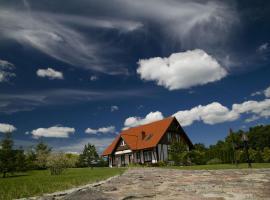 Domek nad Jeziorem Bełdany, Kamień