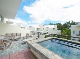 Cape Bay Luxury Beach Apartments by BARNES, Bain Boeuf