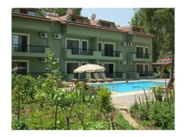 Twins Apart Hotel, Turgut