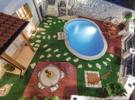 Two-Bedroom Holiday home Grizane with an Outdoor Swimming Pool 05, Grižane