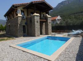 Villa Yesil, Üzümlü