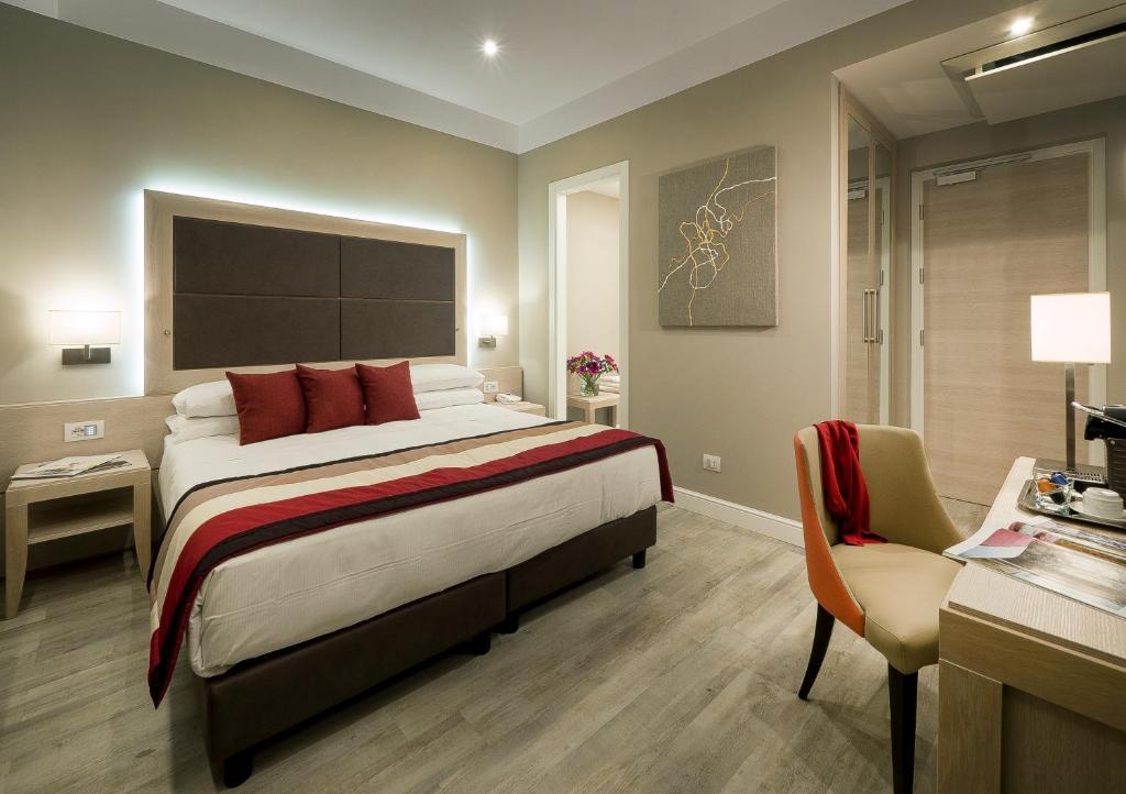 Cama ou camas em um quarto em Hotel Villa Maria Regina