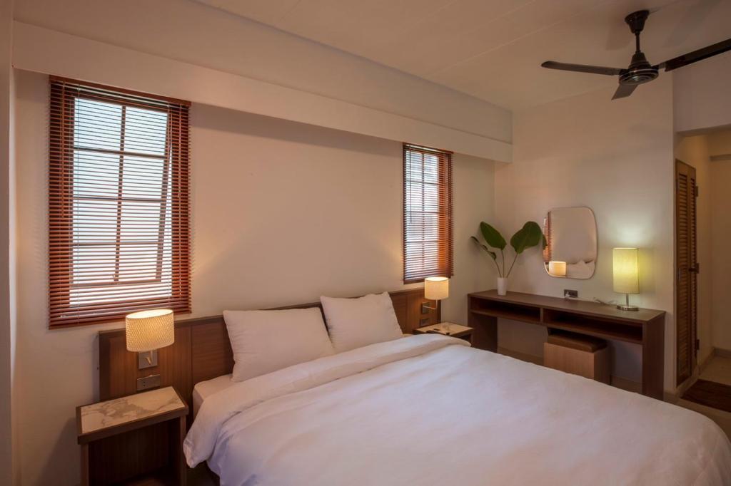 Giường trong phòng chung tại RCN Court & Inn