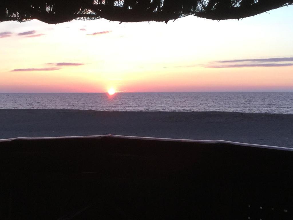 <div data-et-view=NAFQCDCcdXDPdFO:1</div Sea Breeze Beachfront Cottage 1 and 2