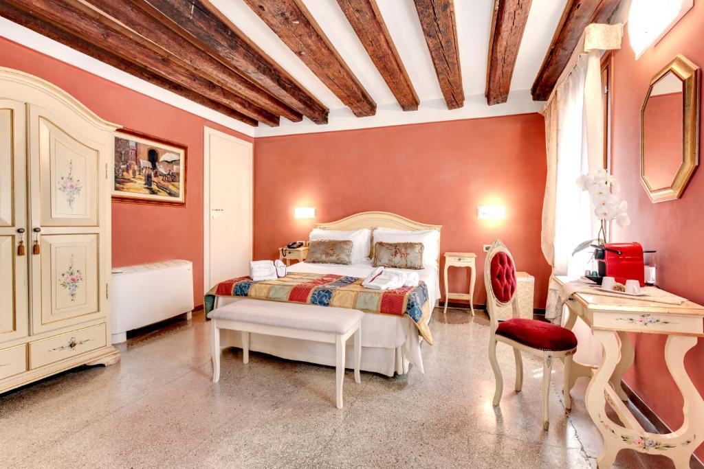 Cama ou camas em um quarto em Ca' Riza