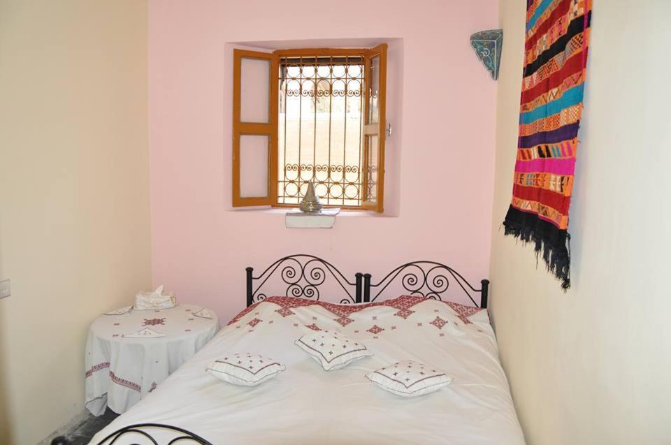 Una cama o camas en una habitación de Dar Pension Talaa