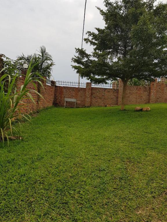 <div data-et-view=NAFQCDCcdXDPdFO:1</div Kitikifumba House