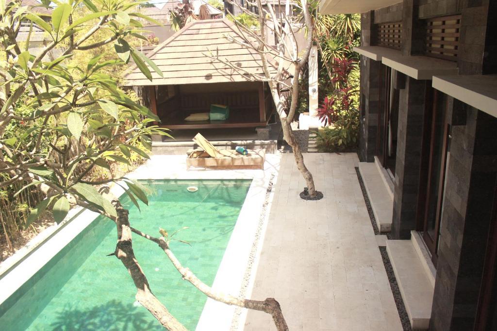 נוף של הבריכה ב-The Bali Bagus Villas או בסביבה