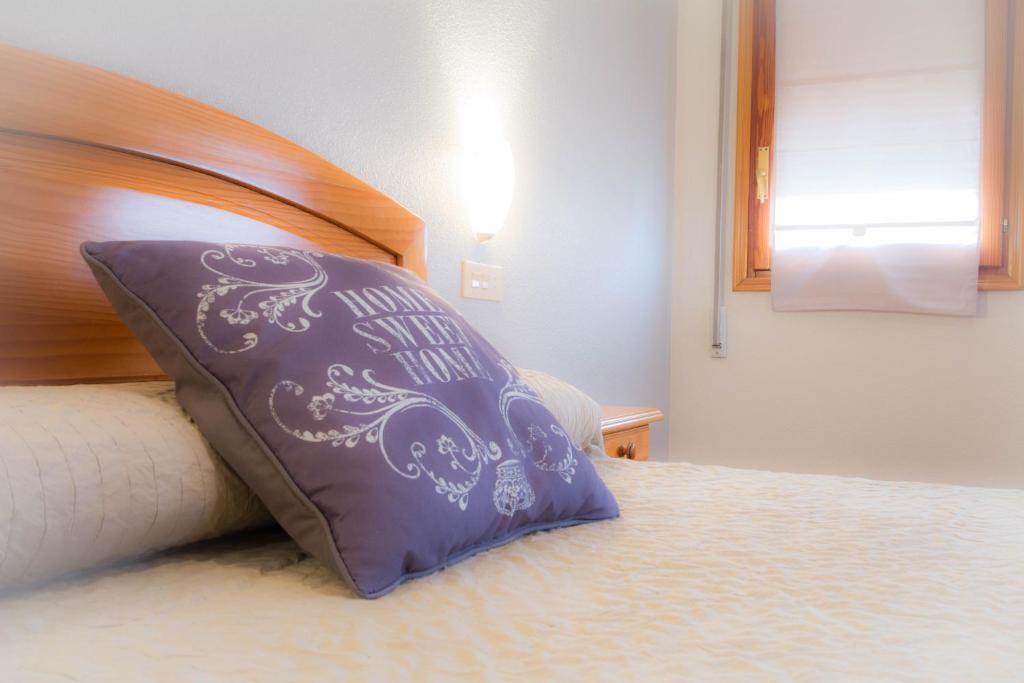 מיטה או מיטות בחדר ב-L'Oncle Pere Habitacions