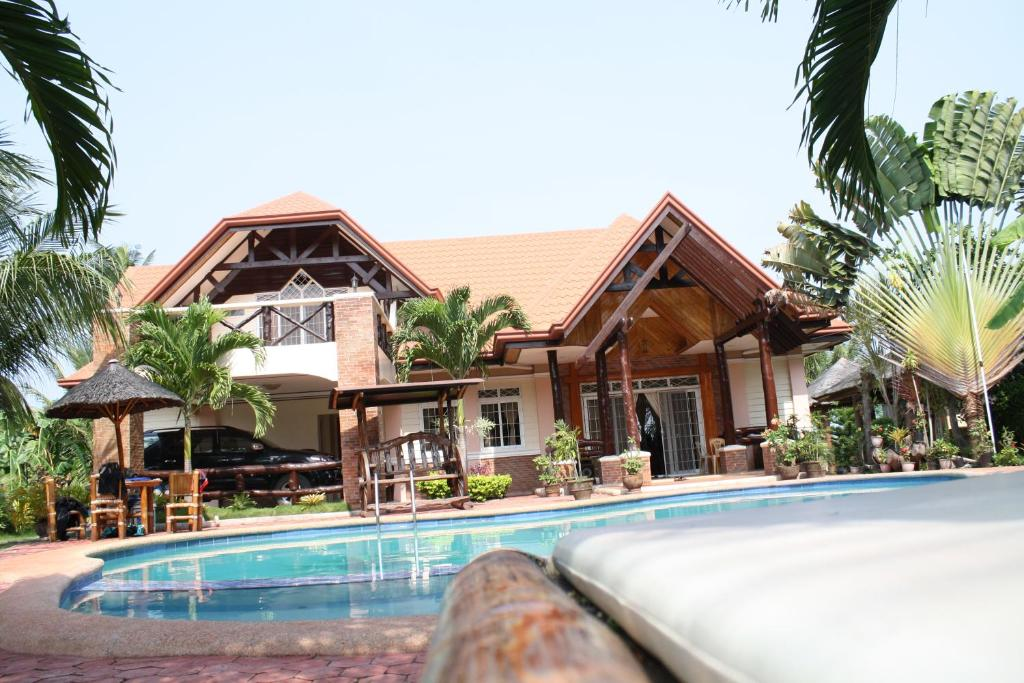 Dumaguete springs beach resort dauin book your hotel Dumaguete hotels with swimming pool