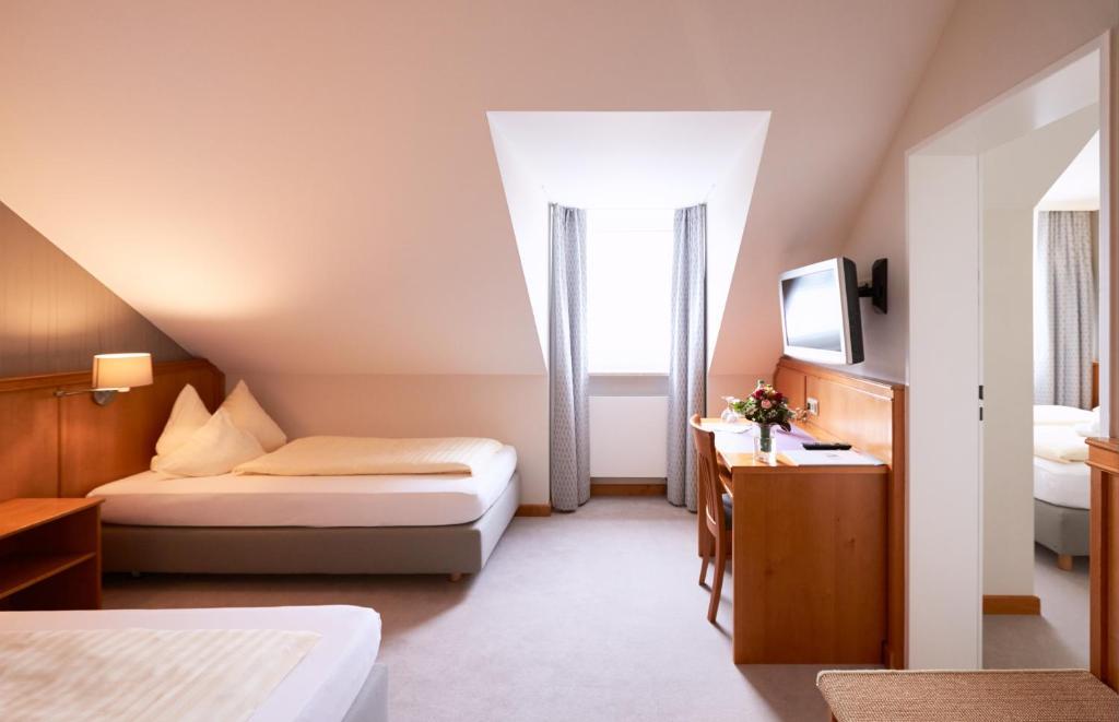 Hotel alter wirt freising reserva tu hotel con viamichelin for Habitaciones familiares italia
