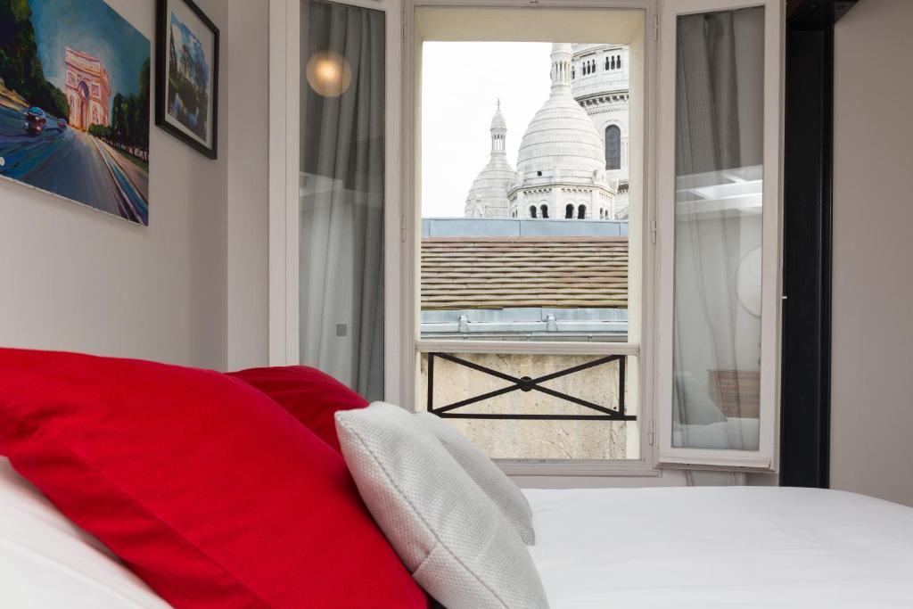 Cama ou camas em um quarto em Ateliers de Montmartre ADM