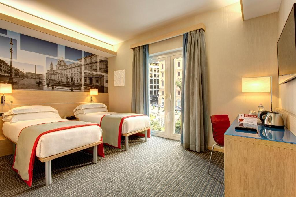 Iq hotel roma rome book your hotel with viamichelin for Hotel roma booking