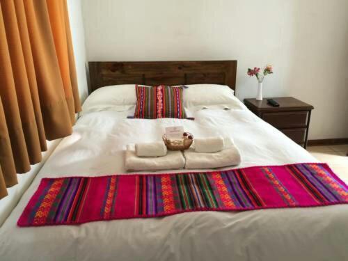 Una cama o camas en una habitación de Chicha Wasi Tilcara