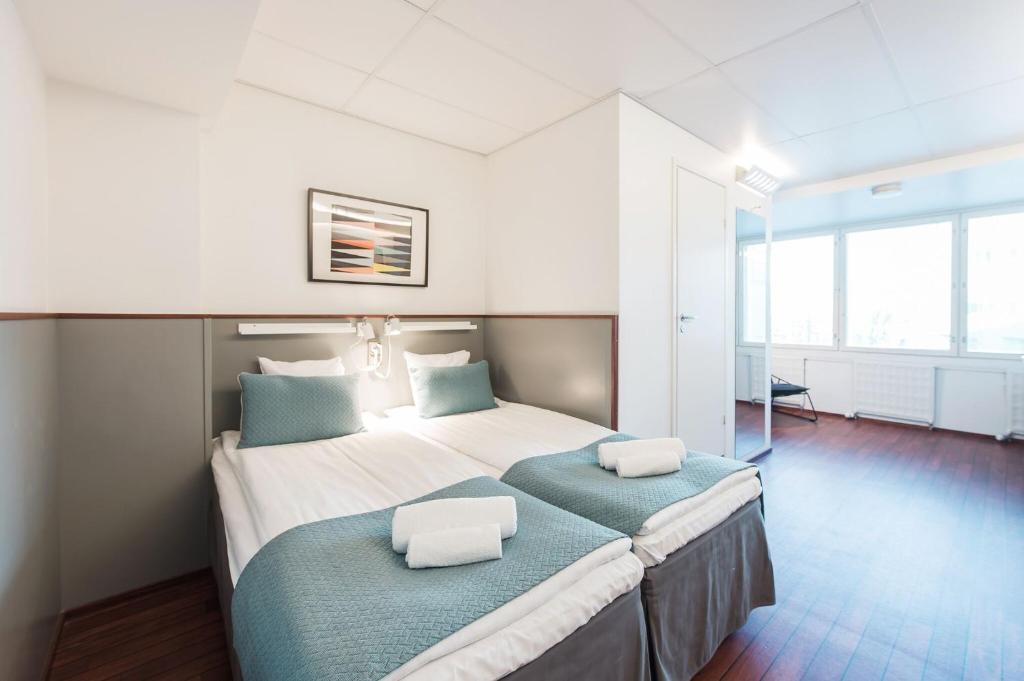 Cama ou camas em um quarto em Forenom Aparthotel Helsinki Kamppi