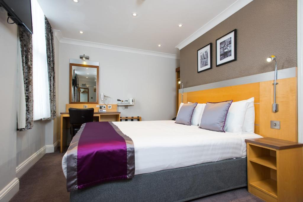 Cama ou camas em um quarto em Best Western Victoria Palace