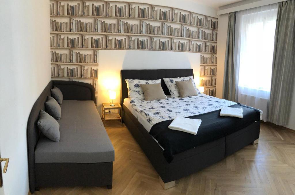 Cama ou camas em um quarto em Agnes - Residence Palladium