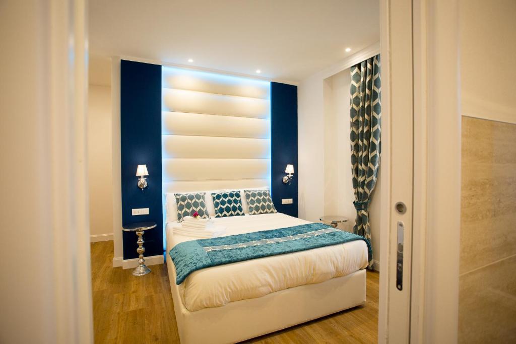 Cama ou camas em um quarto em Atmosfere Guest House - Cinque Terre e La Spezia