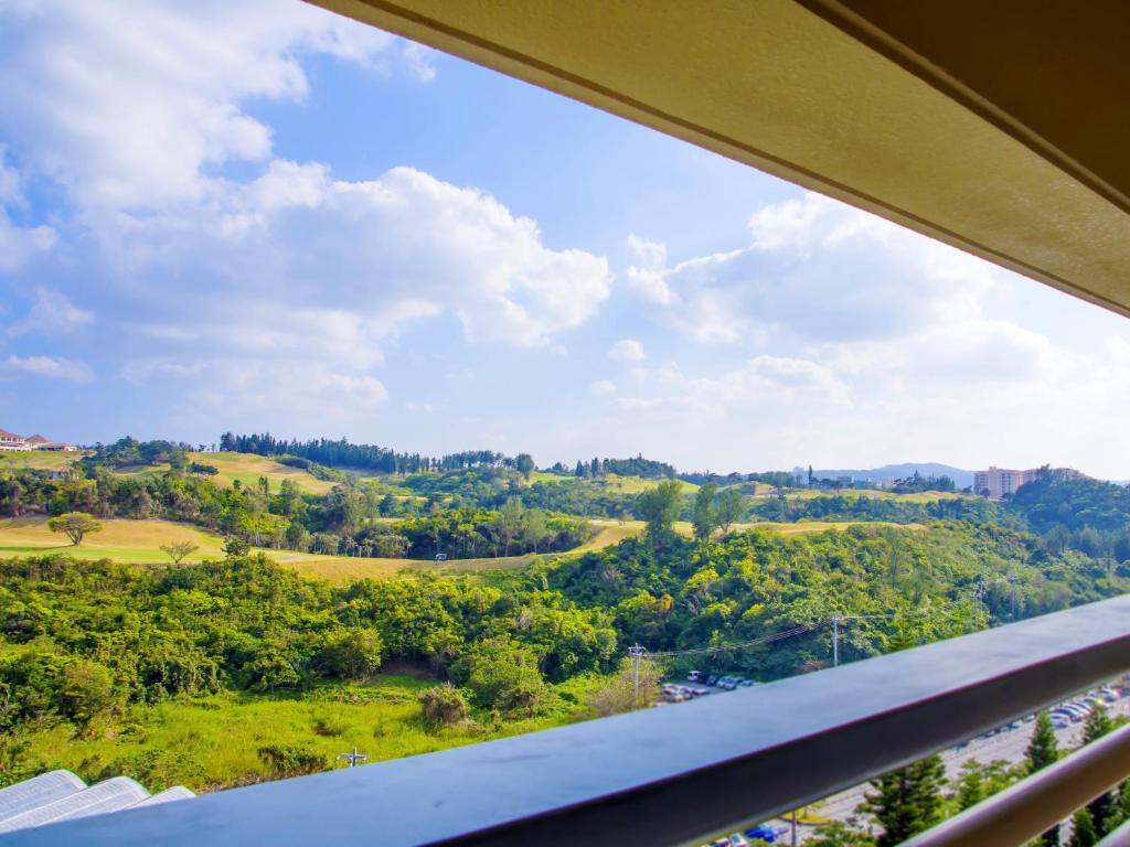 Un balcón o terraza en Rizzan Sea Park Hotel Tancha Bay