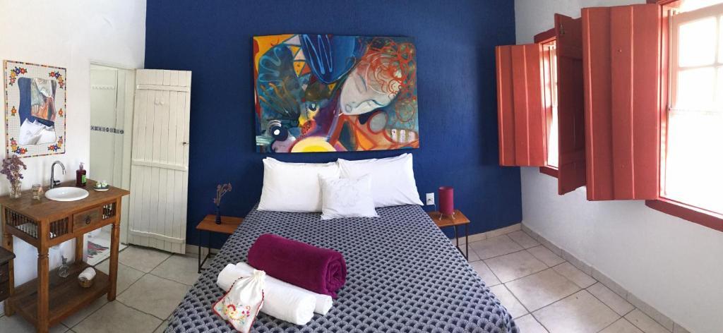 Cama ou camas em um quarto em AZ Hostel & Galeria de Arte