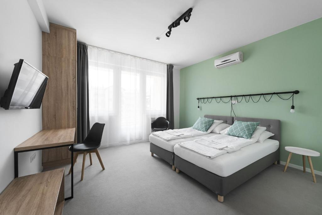 מיטה או מיטות בחדר ב-Hotel Chesscom