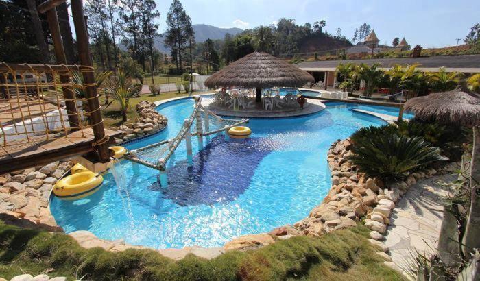 A piscina localizada em Hotel Fazenda Recanto Paraíso ou nos arredores
