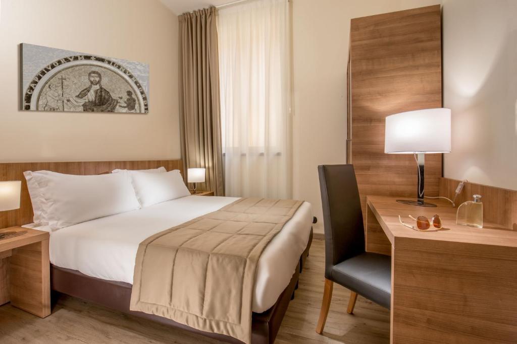 Cama ou camas em um quarto em Casa Santa Maria Alle Fornaci