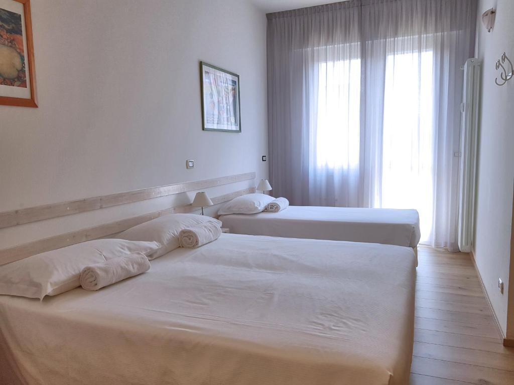 Cama ou camas em um quarto em La Camera Bologna-Stazione Affittaly Rooms
