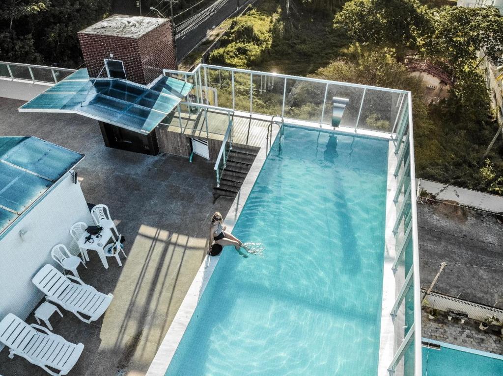 Uma vista da piscina em Oriental Praia Hotel ou nos arredores
