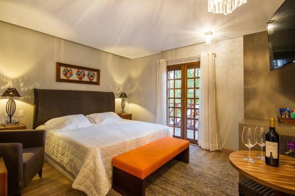 Cama ou camas em um quarto em Pousada Cantinho da Serra