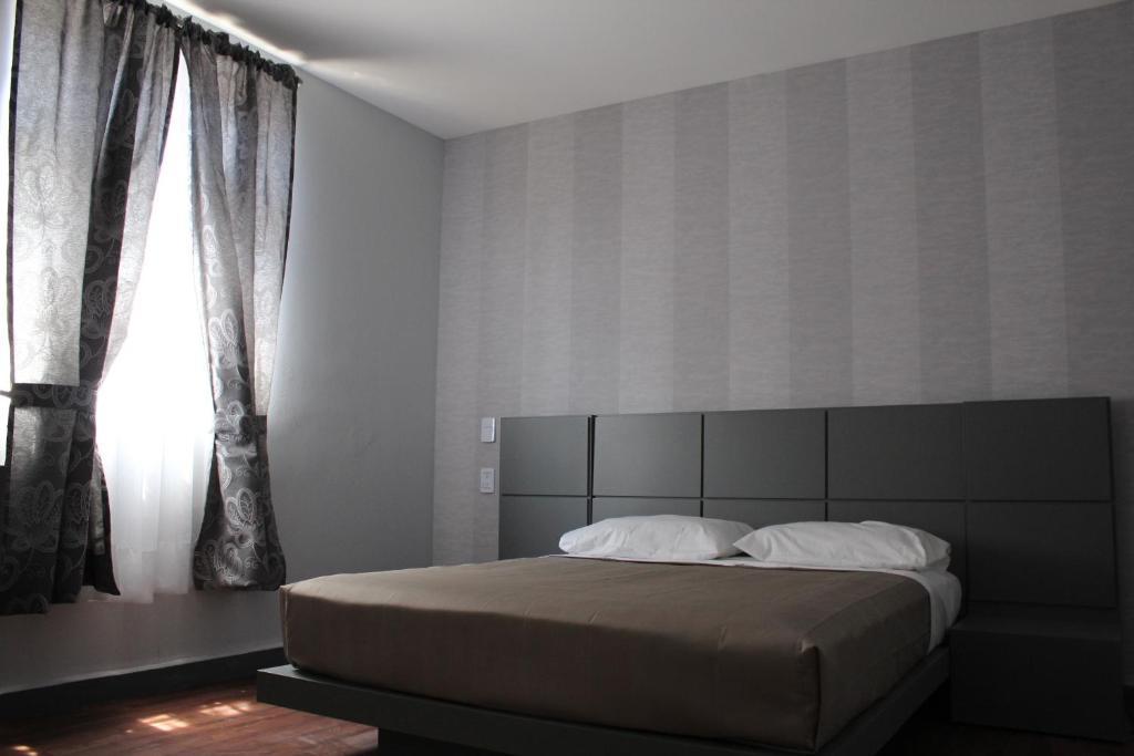 Cama ou camas em um quarto em Hotel Amigo Zocalo