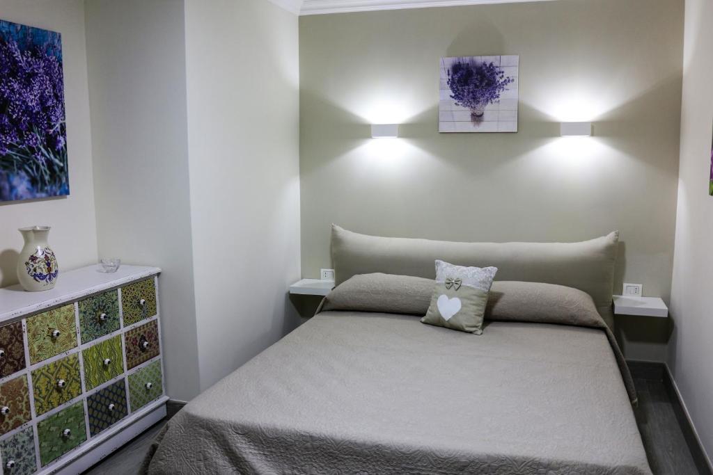 Cama ou camas em um quarto em B&B Arte Napoli