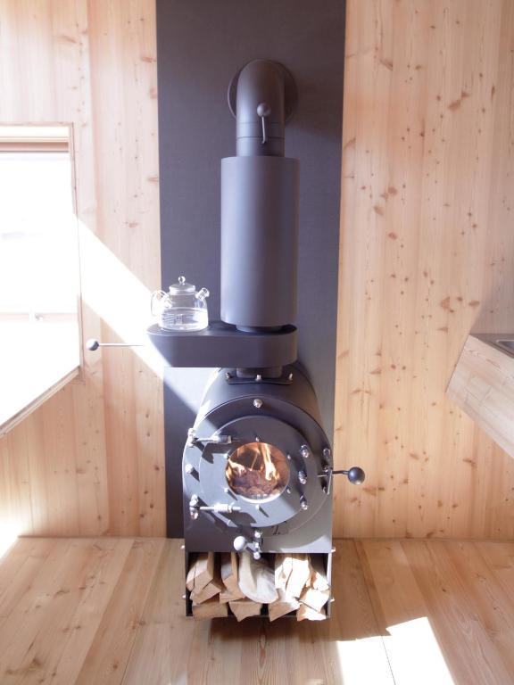 leichte Hanglage mit Alpenpanorama Feriendomizil Holzkörper