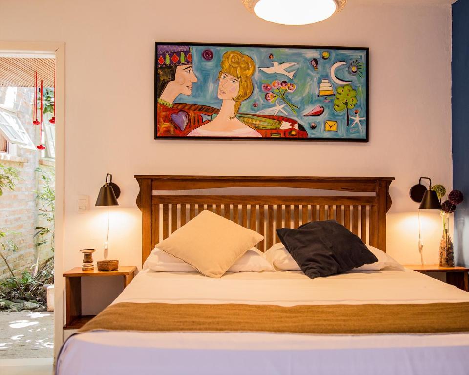 Cama ou camas em um quarto em Pousada Spa Ventos do Camburi