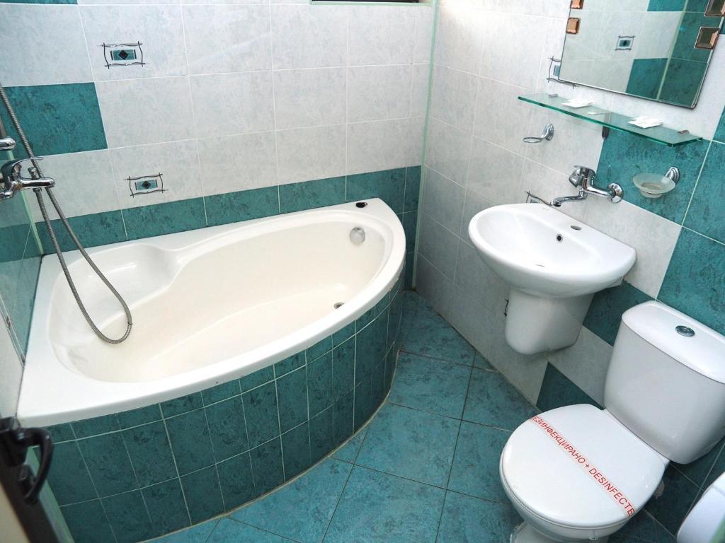 Phòng tắm tại Eos Hotel