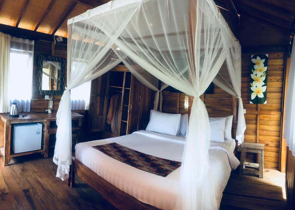 Una cama o camas en una habitación de Doni House & Villa