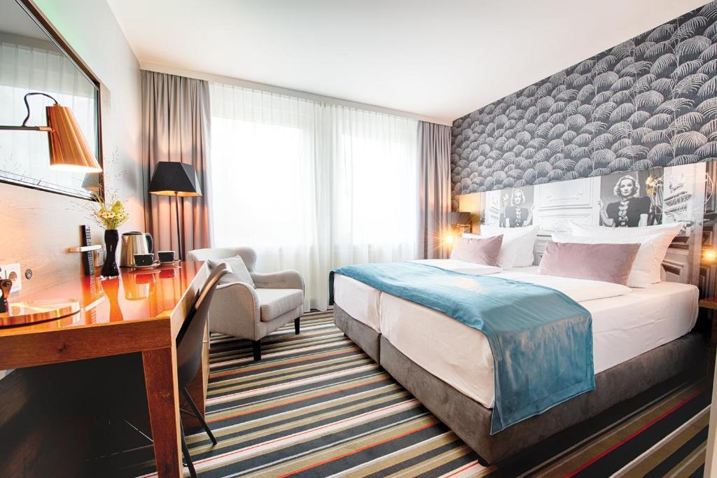 Cama ou camas em um quarto em Leonardo Boutique Hotel Berlin City South