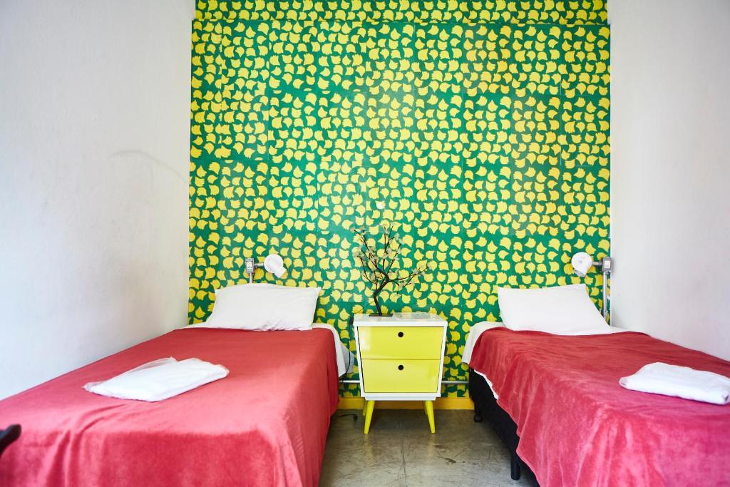 Cama ou camas em um quarto em Hostel Alice