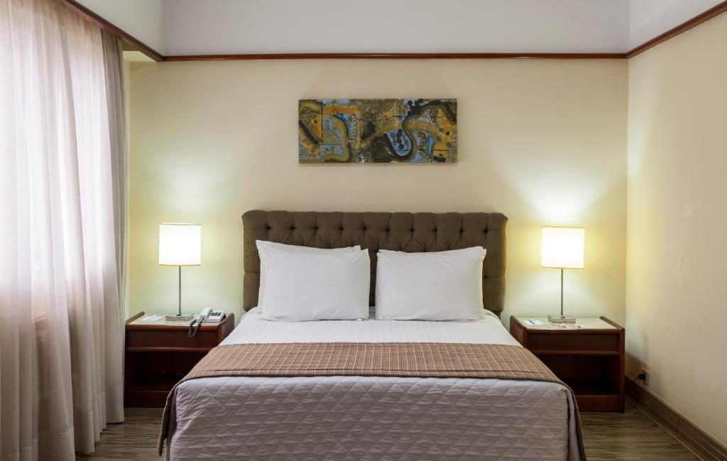 Cama ou camas em um quarto em La Residence Itaim by Manager