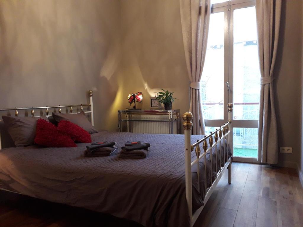 Una cama o camas en una habitación de Villa Apollo