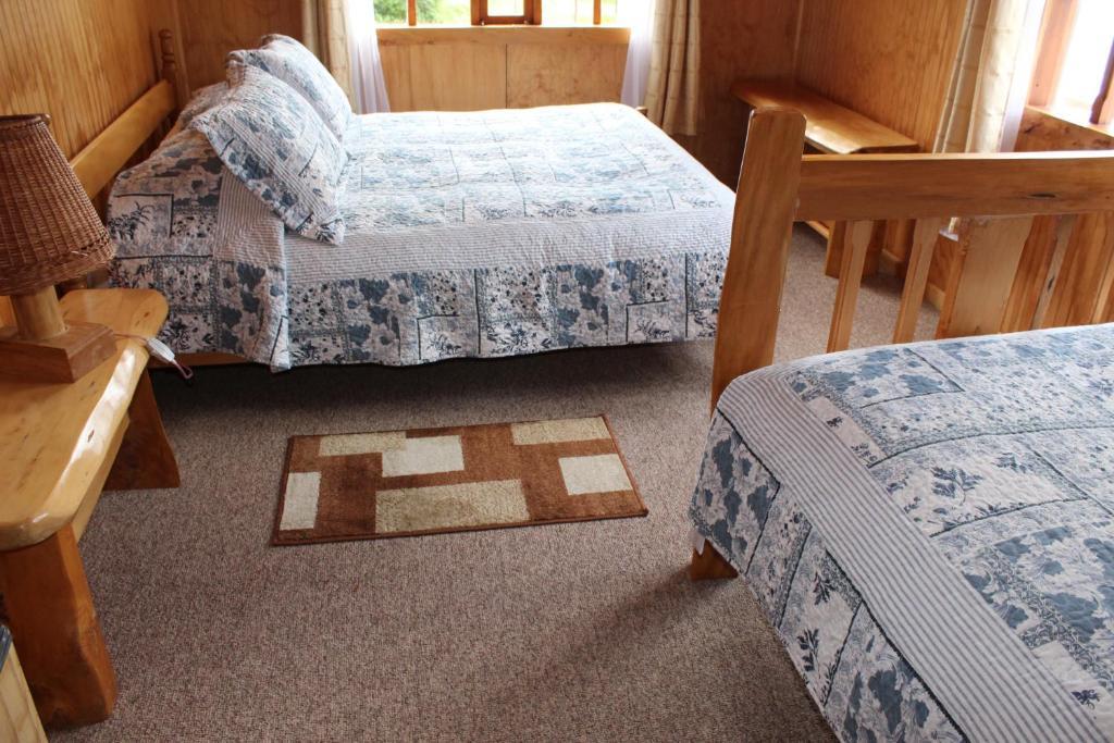 Cama ou camas em um quarto em Los Mañíos Del Queulat