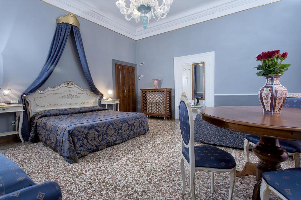 Una cama o camas en una habitación de Hotel Mezzo Pozzo