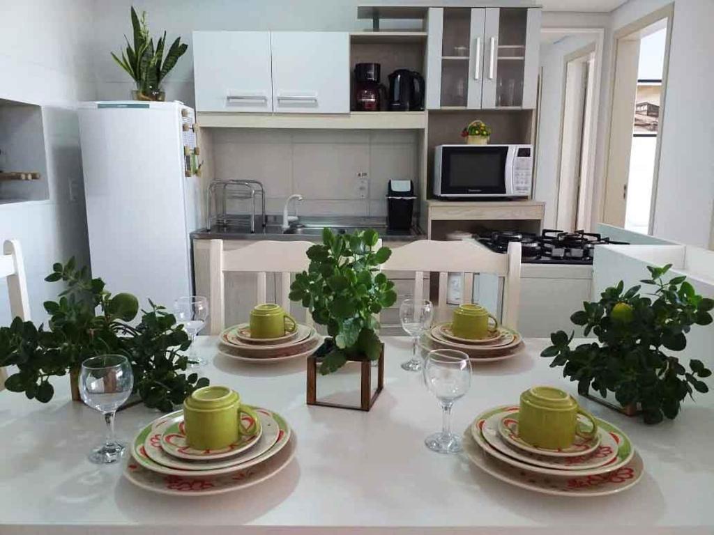 A cozinha ou cozinha compacta de Flat Vinhedos Charme