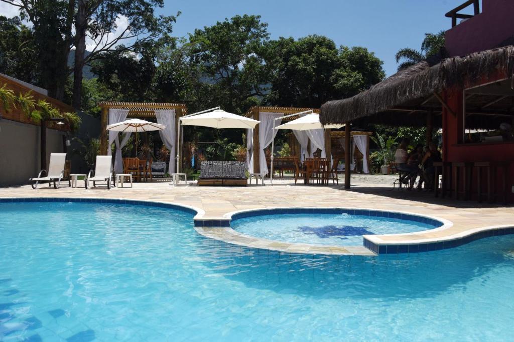 A piscina localizada em Pousada Porto Mare ou nos arredores