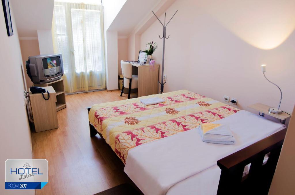 Garni hotel lotos ni reserva tu hotel con viamichelin for Habitaciones familiares italia