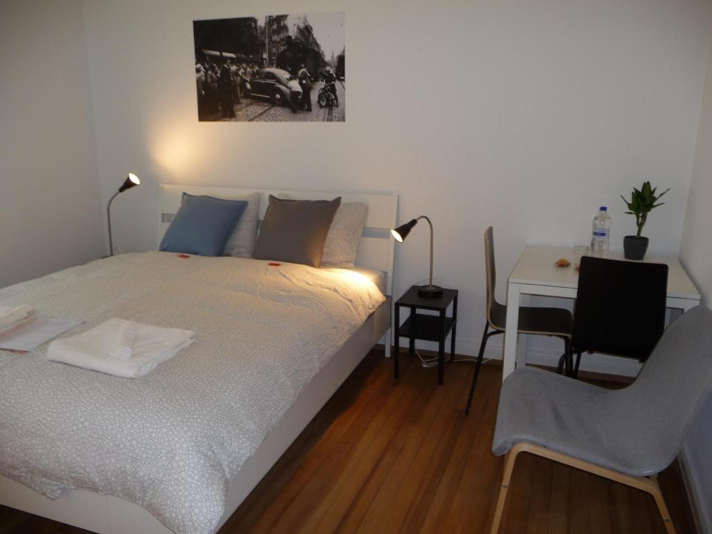 Cama ou camas em um quarto em rooms lux city