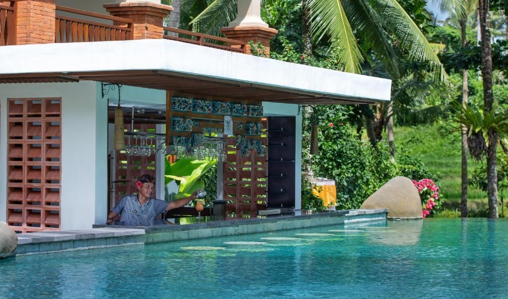 La pileta dentro o cerca de Green Field Resort Ubud
