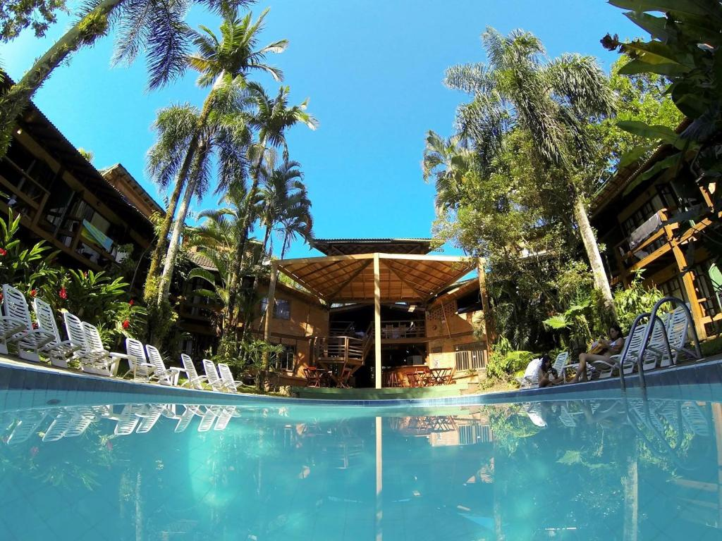A piscina localizada em Pousada das Praias ou nos arredores