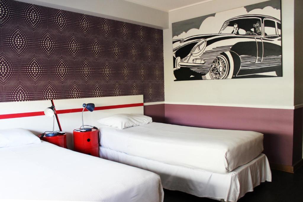 Cama ou camas em um quarto em Rado Boutique Hostel