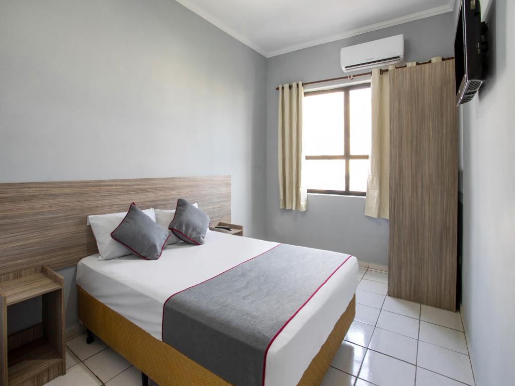 Cama ou camas em um quarto em OYO Hotel Centro Brás